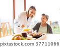 Health visitor and a senior woman during home 37711066