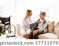 Health visitor and a senior woman during home 37711070