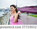 Travel Concepts. Beautiful girl relaxing on the beach. Beautiful 37729032
