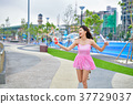 Relaxation concept. Asian girls are playing bubbles with fun. Be 37729037
