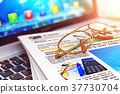 Stack of newspapers on laptop and eyeglasses 37730704