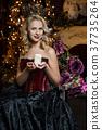 Beautiful witch in dark dress 37735264