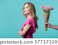 Offended girl refusing to receiving bouquet 37737320