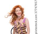 Headshot of a redhead in a colourfull dress. 37747657