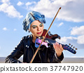 Woman perform music on violin park outdoor. Girl 37747920