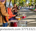 Festival music band. Friends playing on percussion 37753321