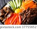 Bibimbap with beef, yolk, vegetables, mushrooms 37755652