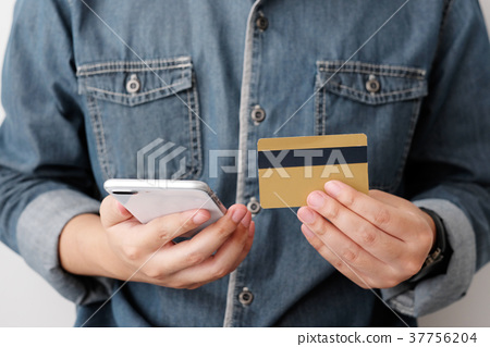 Man hands using smart phone and credit card 37756204