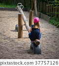 little girl alone in a playground 37757126