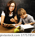 little cute boy with teacher in classroom 37757854