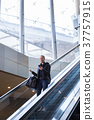 Businesswoman with large black bag and mobile 37757915