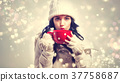 Woman in winter clothes drinking coffee 37758687