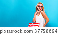 Young woman holding a shopping bag  37758694