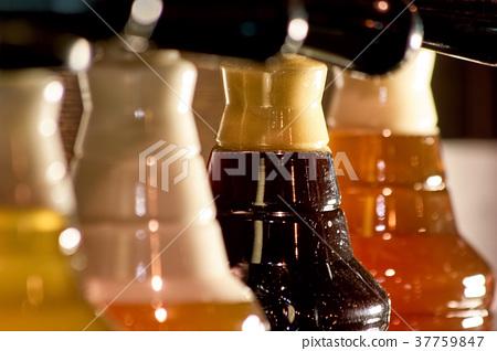 Close up plastic bottlnecks with foam. 37759847