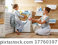 Happy family mother housewife and child   in laundry with washin 37760397