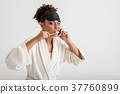 Serene woman brushing her teeth 37760899