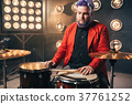 Bearded drummer in red suit, vintage style 37761252