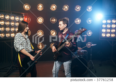 Guitarists plays on electric and bas guitar 37761258