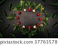 Fresh radish frame on black background. 37763578