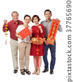 Family with traditional decorations 37765690