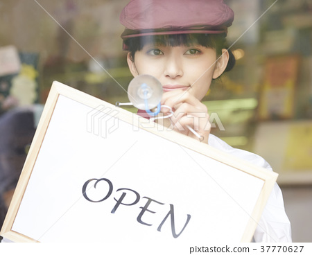 Woman doing part-time job at a cake shop 37770627