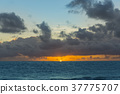 Dramatic sunset over ocean waves. Clouds 37775707