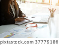 Businesswoman working on office with smartphone. 37779186