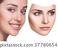 Woman hiding hapyiness under the serious mask 37780654
