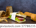 sandwich ham lettuce tomatoes French bread almonds 37786235
