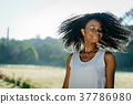 Charming african girl with closed eas and green 37786980