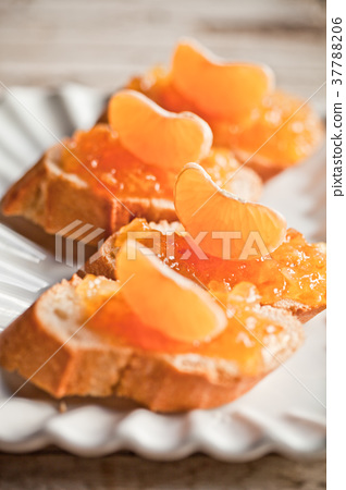 pieces of baguette with orange marmalade 37788206