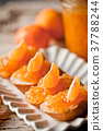 pieces of baguette with orange marmalade 37788244