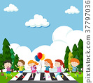 Many children crossing street 37797036