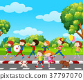 Children in band marching in park 37797070