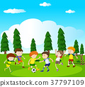 Boys playing soccer in park 37797109