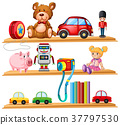 Many toys and books on wooden shelves 37797530