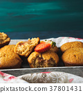 Peanut butter muffins with strawberry jam 37801431