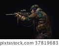 soldier of the American special forces with a rifle chooses a target 37819683