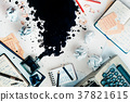 Writer workplace with spilled ink, stationery and 37821615