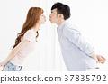 closeup young asian couple kissing 37835792
