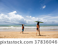 Young boy and girl with surfing board on the beach 37836046