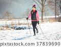 Fit woman Nordic walking in winter landscape 37839690