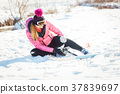 Woman falling while doing cross country skiing 37839697