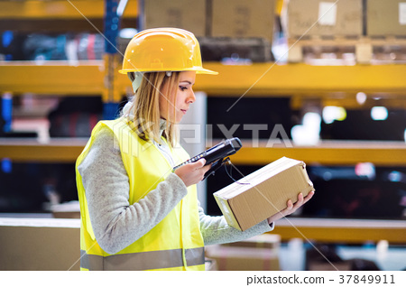 Warehouse woman worker with barcode scanner. 37849911