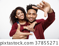 Happy young African American couple looking 37855271
