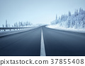 road in winter forest 37855408