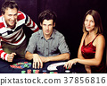young real people playing poker, lifestyle people 37856816