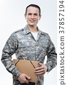 Positive military man holding a folder 37857194