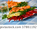 Delicious Mediterranean seafood shrimps and crawfish close up 37861192