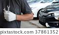 Mechanic repairing a car  in garage  Auto repair  37861352